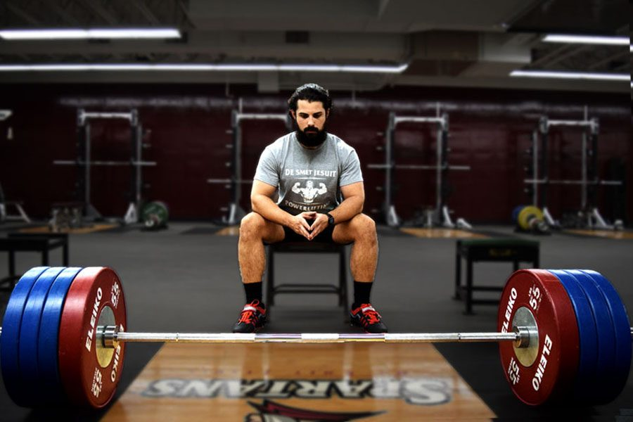 English teacher Christopher Farrell, S.J. pauses for a quiet moment before deadlifting 425 pounds. Farrell started a powerlifting club which meets every day after school.