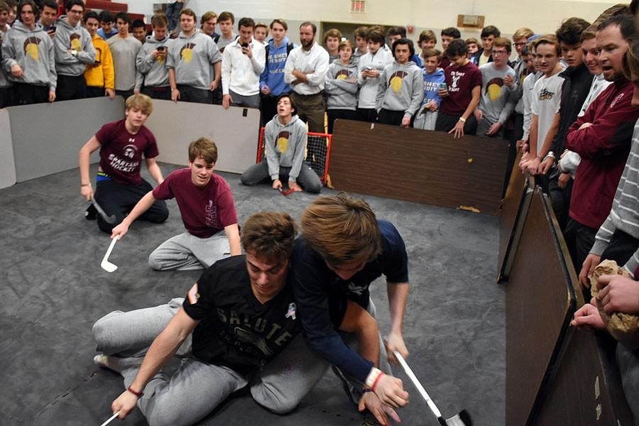 Students battle in a Shinny Hockey game . The tournament helped raise money for Amigos for Christ in Belize and St. Matthew the Apostle Parish in the Ville.