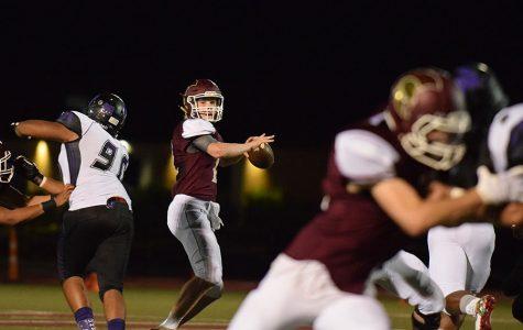 Sophomore quarterback Nate Martens looks down field for an open receiver against Fort Zumwalt West Sept 2.