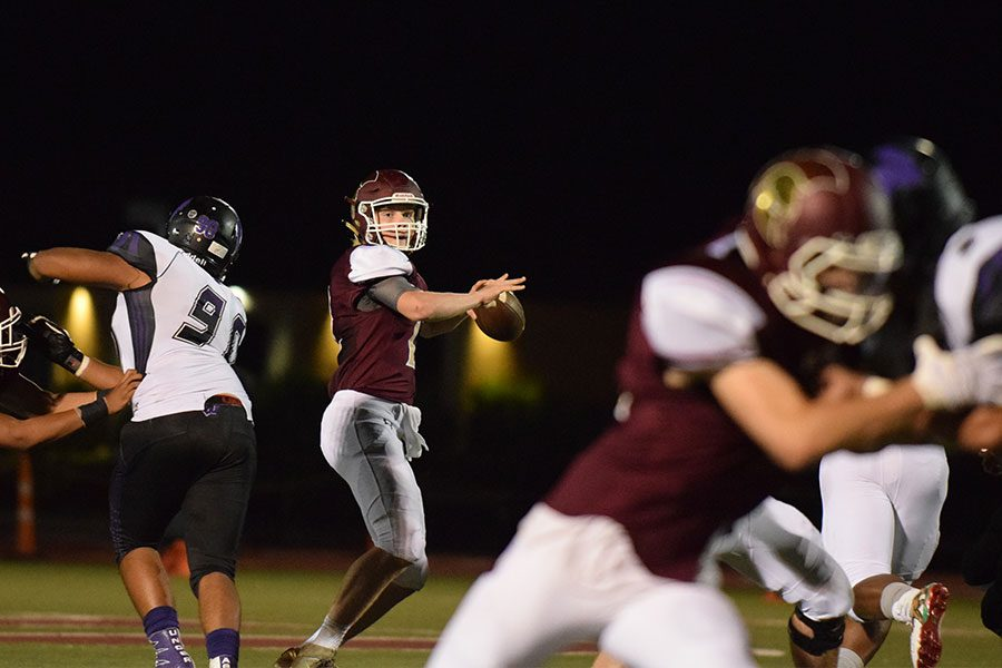Sophomore quarterback Nate Martens looks down field for an open receiver against Fort Zumwalt West Sept 2.