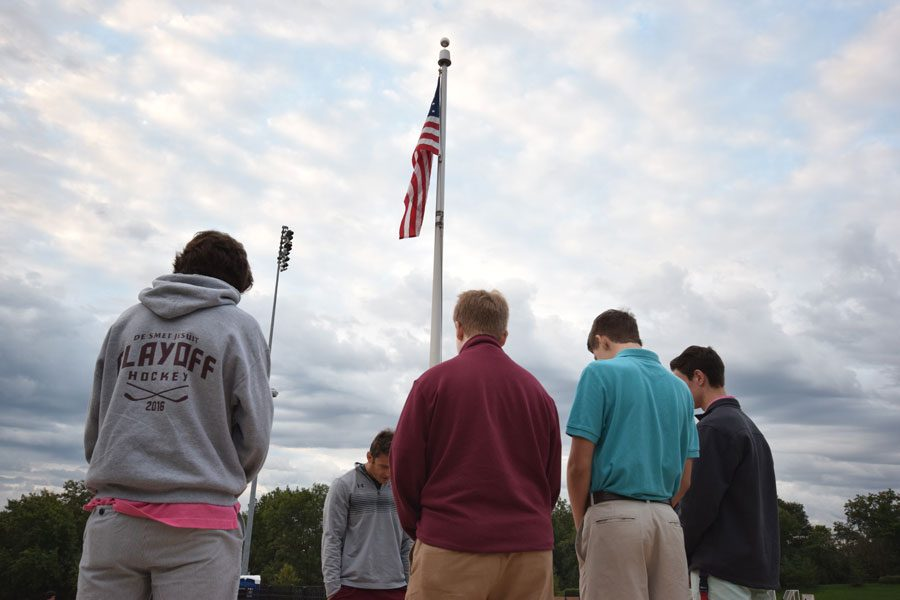 In solidarity with students around the world, senior Andrew Smith, sophomore Sean Fletz, sophomore Chris Williams, and junior Alex Meyers gather at 7am for See You at the Pole day.