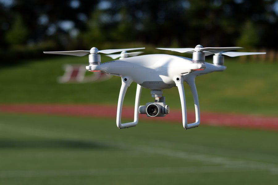New Phantom 4 drone hovers above the turf field.