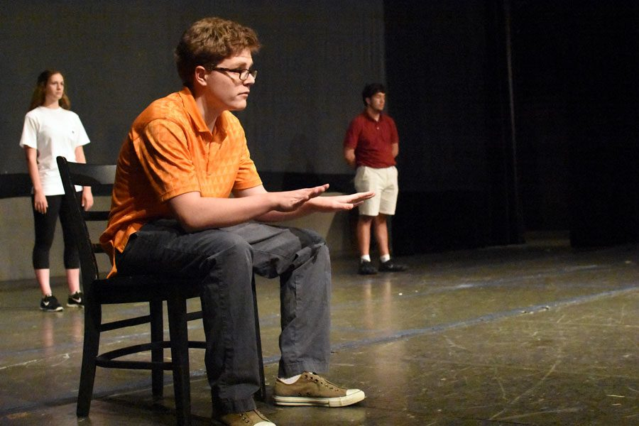 Junior Will Brown reads his lines during rehearsal of
