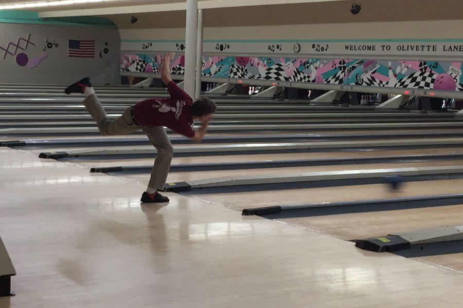 Senior Karl Frank throws the bowling ball down the lane for a strike.