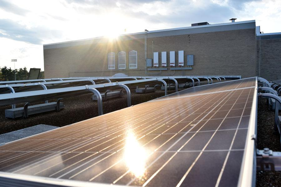 The development of solar power, like those on the school's roof, should be a priority for the new conservative regime.