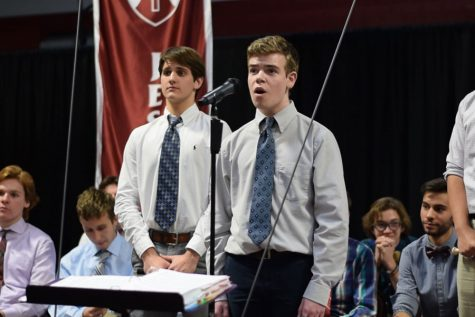 Freshman Thomas Schartner sings at Thanksgiving mass