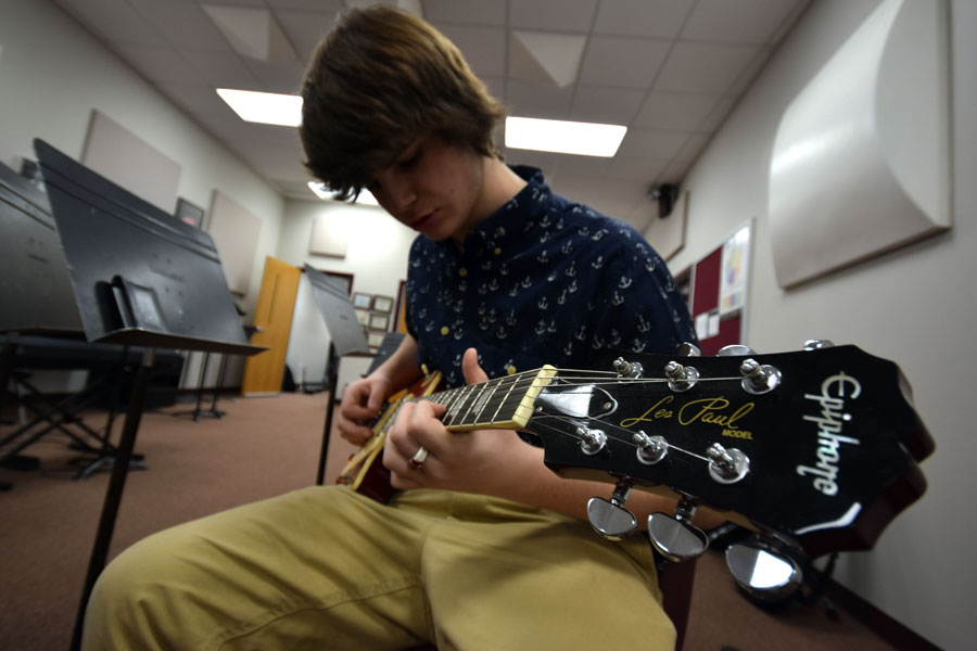 Sophomore Jeff Patterson plays his guitar in the band room after school