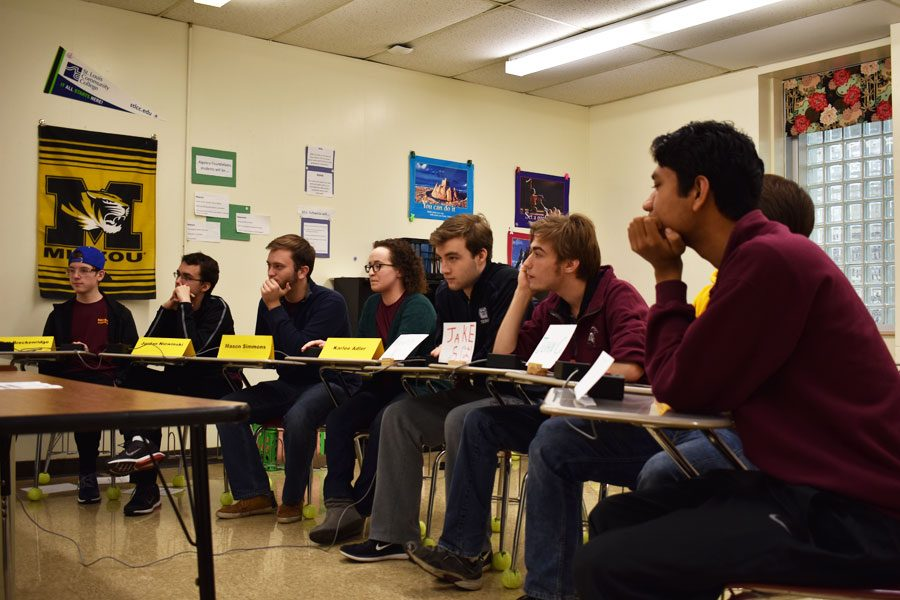 The varsity scholar bowl team awaits the start of the Oakville tournament on Jan. 21.