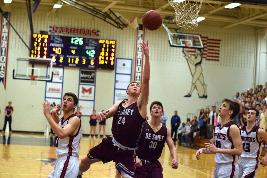 In the final minutes minutes of the game, senior Ryan Stipanovich shoots the ball in an attempt to build a lead.