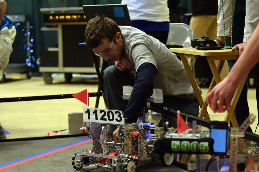 Senior Patrick Sanchez makes an adjustment to the teams robot during the First Tech Challenge (FTC) State Championship March 4 at Missouri S&T in Rolla.