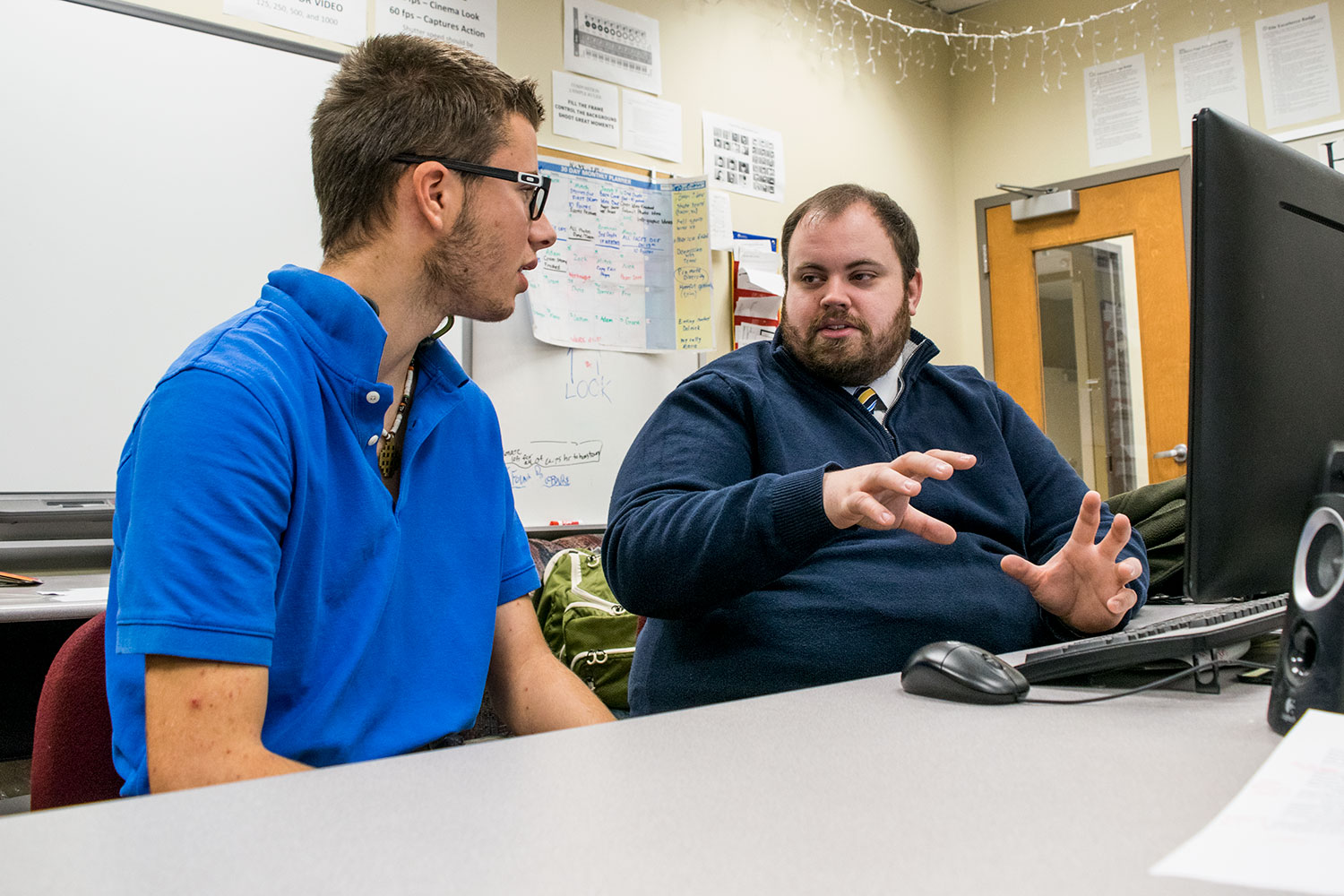 In an effort to improve his programming skills, senior Justin McNeil discusses the C# program with computer science teacher Ryan Sextro. McNeil is learning the computer language as part of his independent study program.