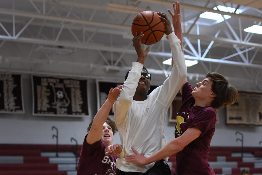 Student goes up for the layup while trying to draw the foul.