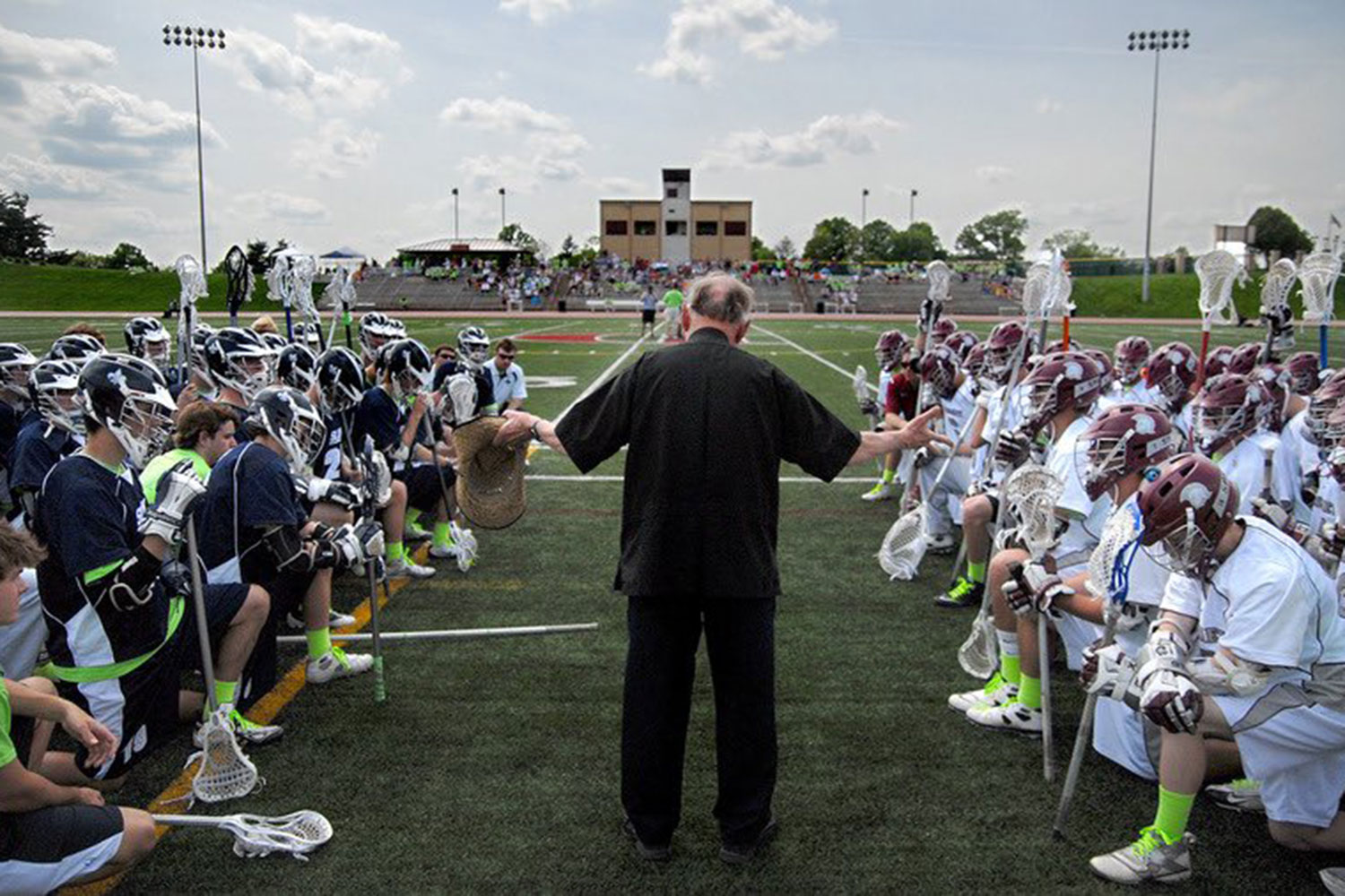 Both De Smet and SLUH's lacrosse teams are blessed before the big game.
