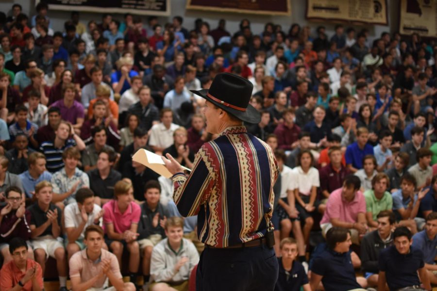 Physics teacher Gene Bender speaks to students at Big Draw assembly