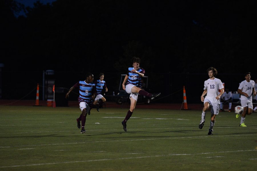 Sophmore Thomas Redmond takes a shot on goal against Columbia Hickman Spt. 5.
