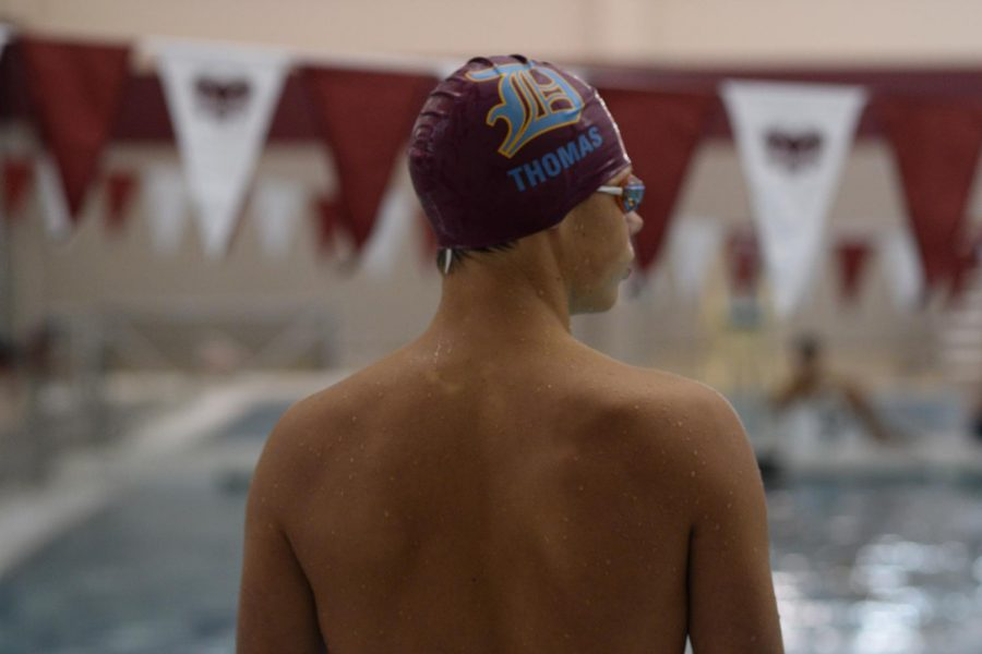 Slideshow of varsity swimming versus MICDS