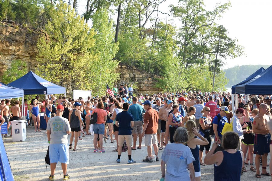 Swim Across America participants listen to personal stories from cancer survivors. The event raised over $200,000 for cancer research.