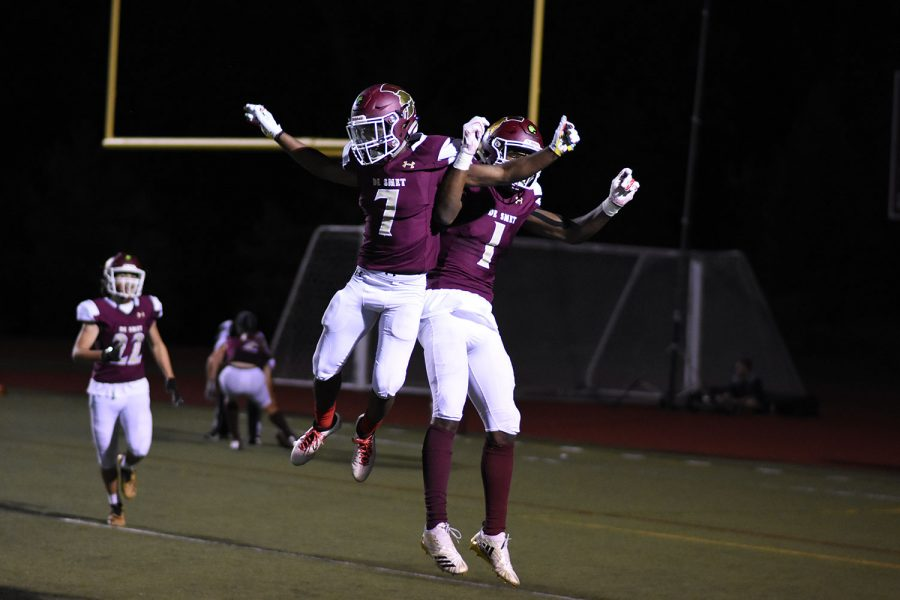 Ra'shod Harvey-smith (left) and Junior Jordan Johnson (right) celebrate after a touchdown versus Vianney on Friday Sept. 21.