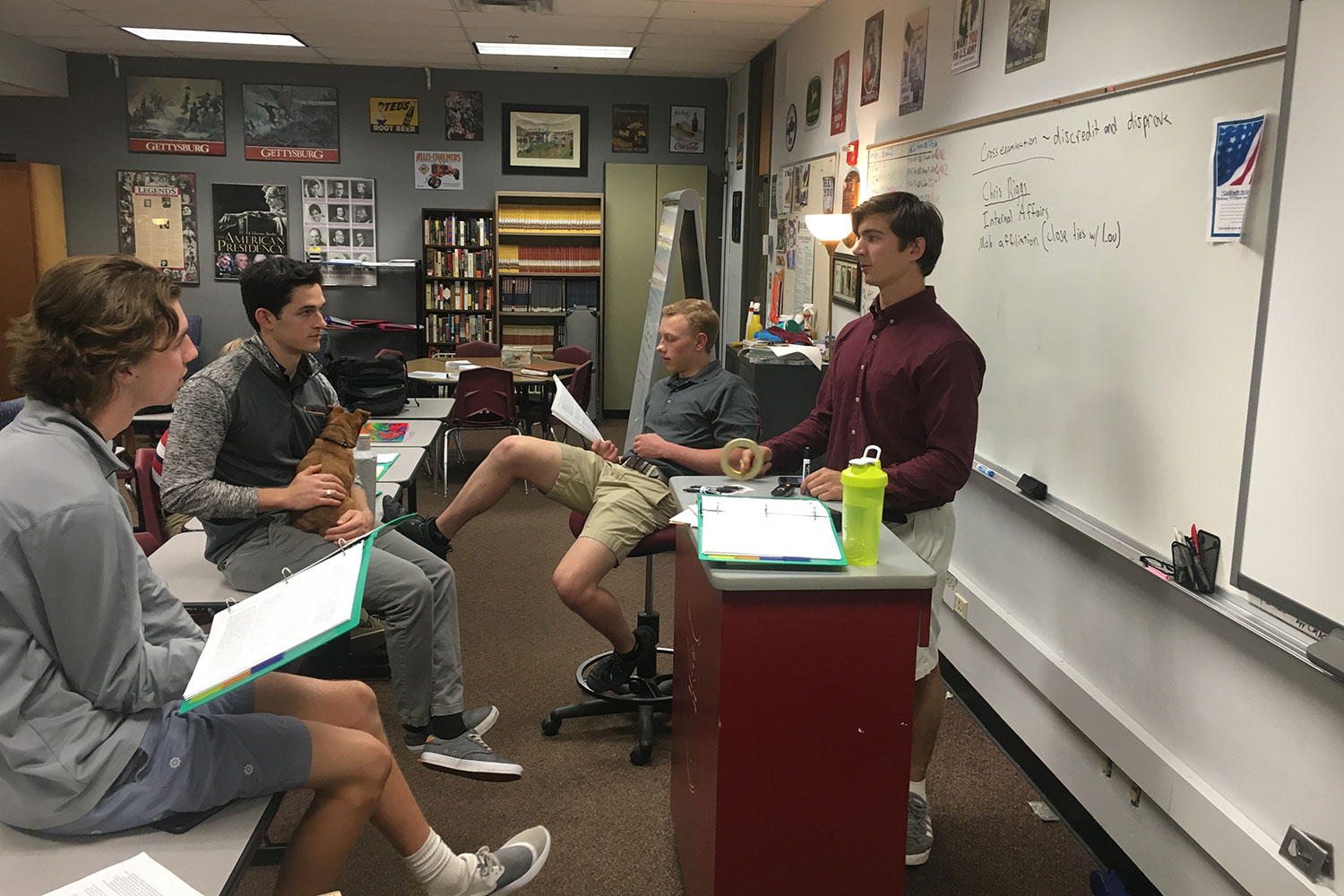 Senior Troy Schneider talks to the Mock trial team about the case.