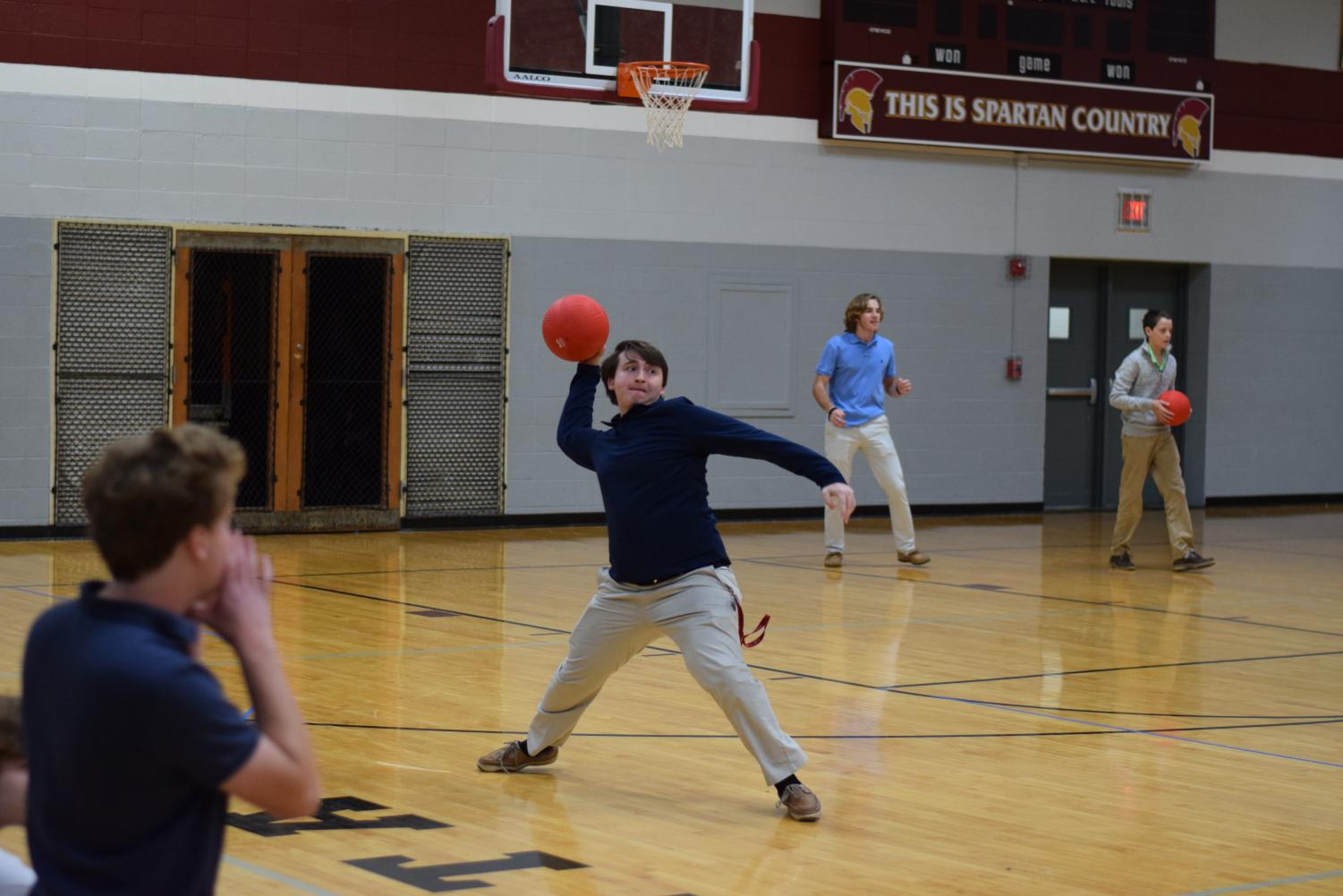 Senior Matt Linomaz launches a dodge ball toward the opposing team to win the competition for his house.
