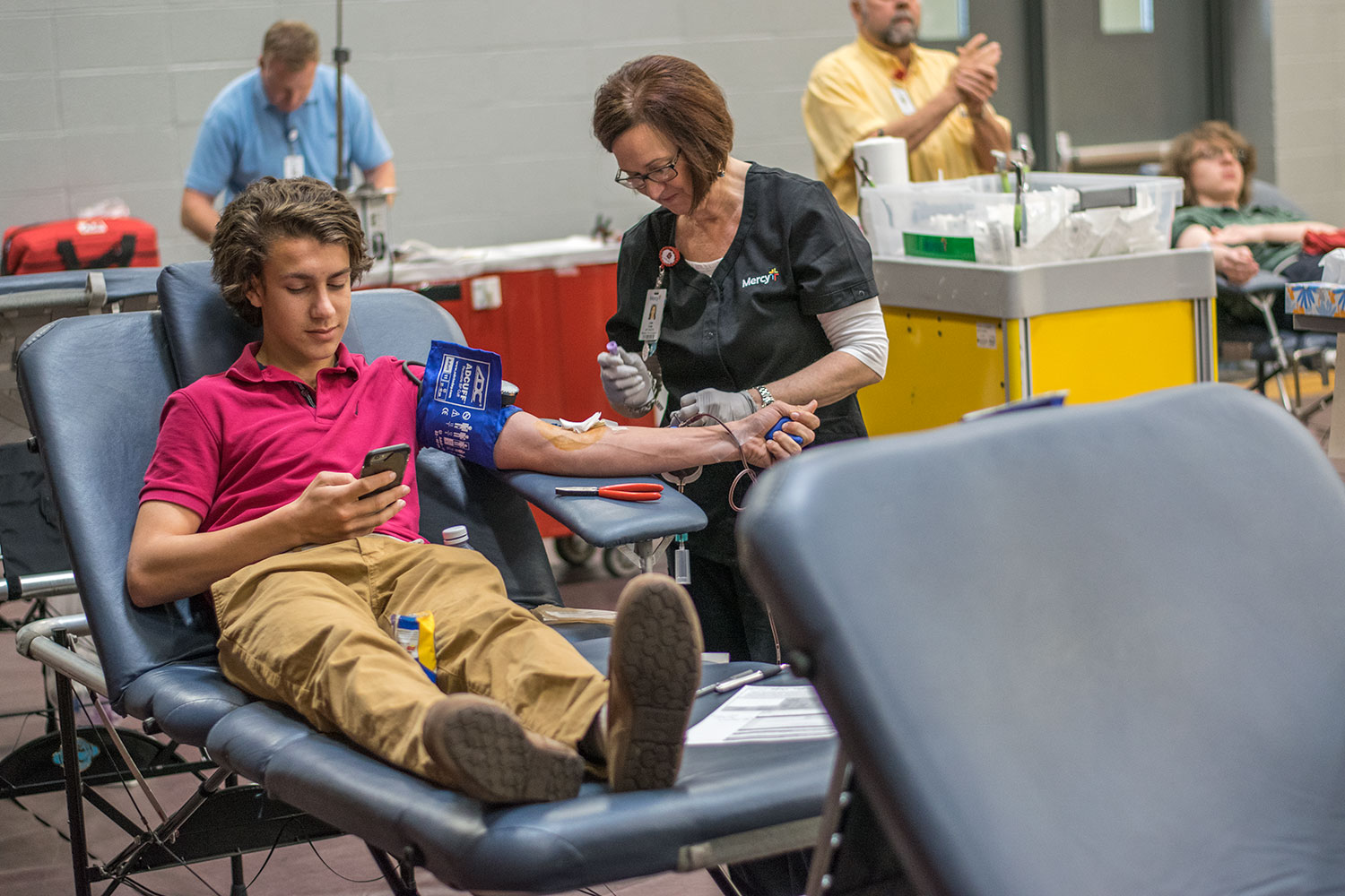 Mercy hospital nurse takes blood from then junior Michael Donlin.  Mercy hospital will visit the school on Nov. 9. Sign ups will be available through email and at lunch.