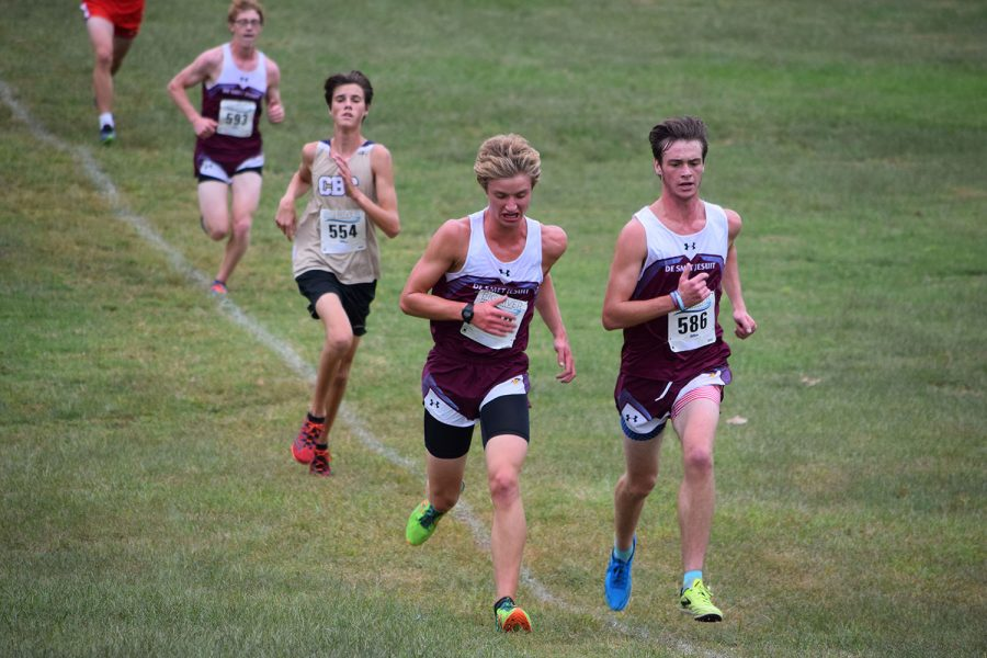 With less than 100 meters to go senior Nick Einig and senior Joseph Moffat attempt to hold off a CBC runner. Einig finished 11th, while Moffat finished 14th, helping De Smet earn a 2nd place team finish.