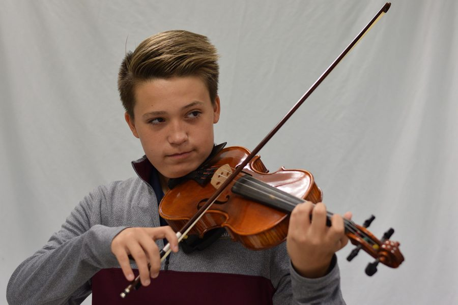 Freshman+Emmet+Concanon+plays+his+violin.+This+past+summer+Concanon+traveled+with+an+orchestra+across+Europe.
