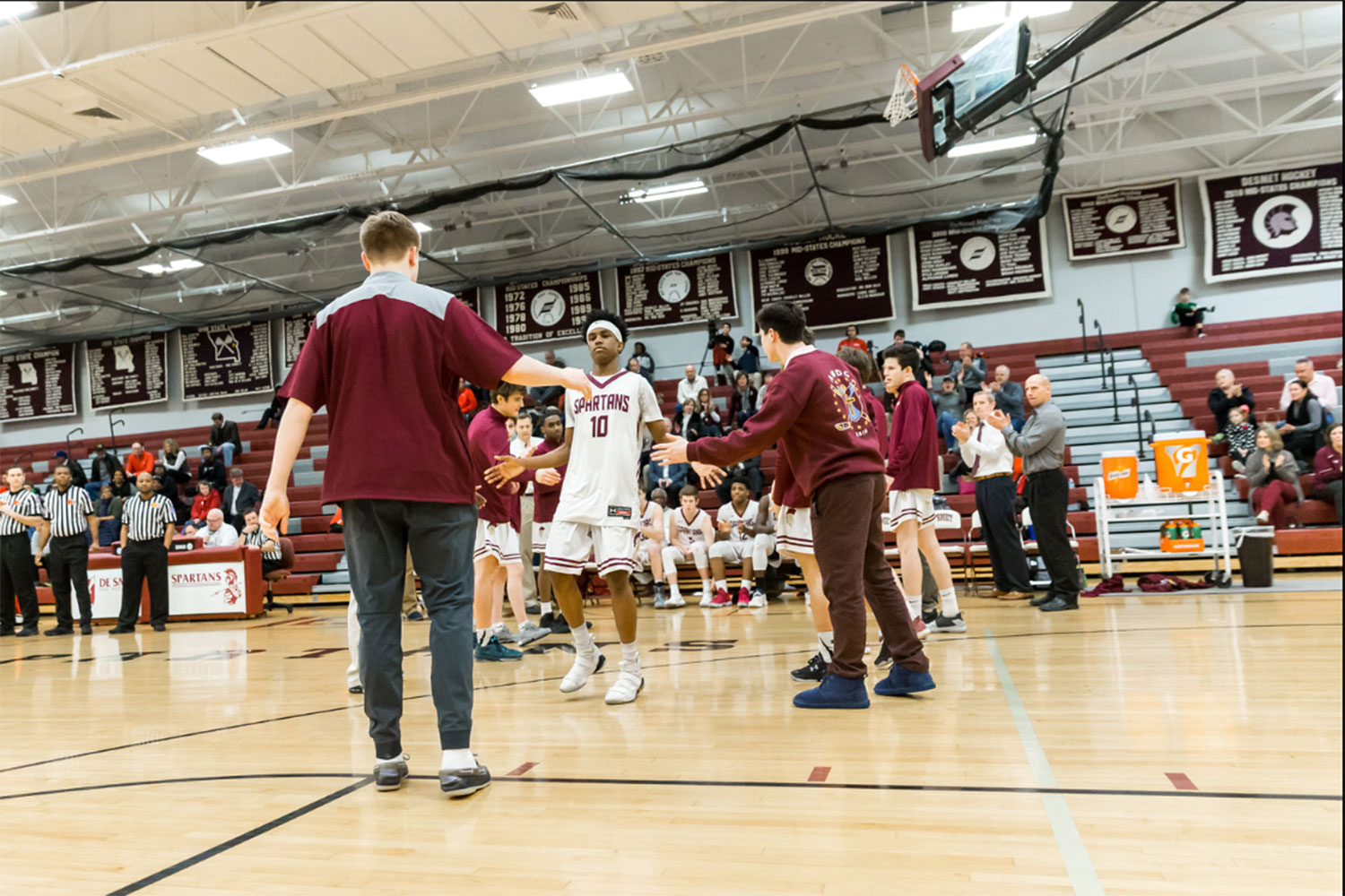 Senior Cameron Range cheers on the varisty basketball team after a basket.