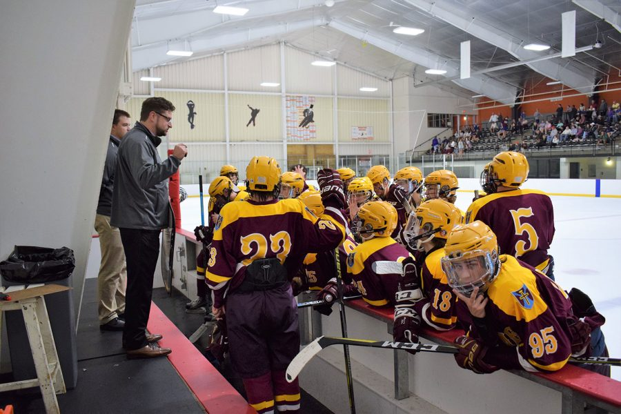 In between the second and third period coach Durso is tells the team what they need to focus on to win the game.