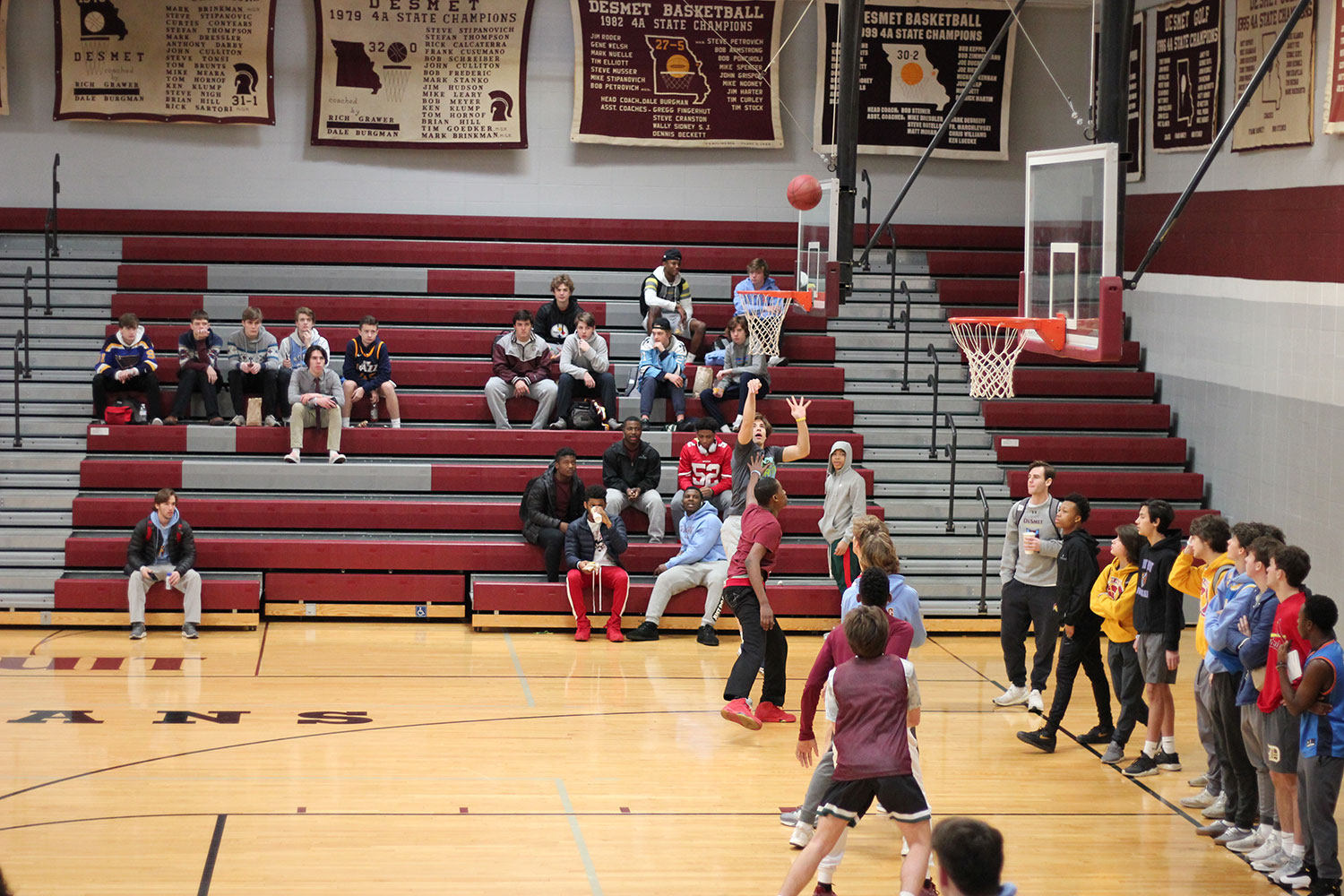 Senior Luke Wetzel steps back and shoot a three pointer to extend their lead.