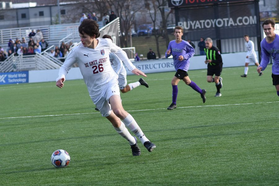 Sophomore Thomas Redmond dribbles the ball during the CBC state soccer game.