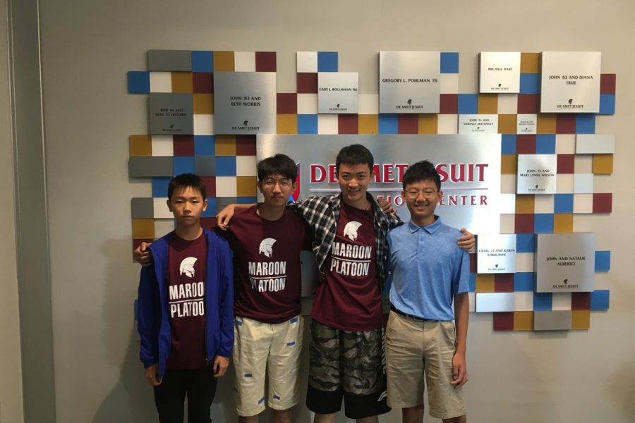 Vic, Allen, Eddie, and Tony take a photo in front of the De Smet Innovation Center