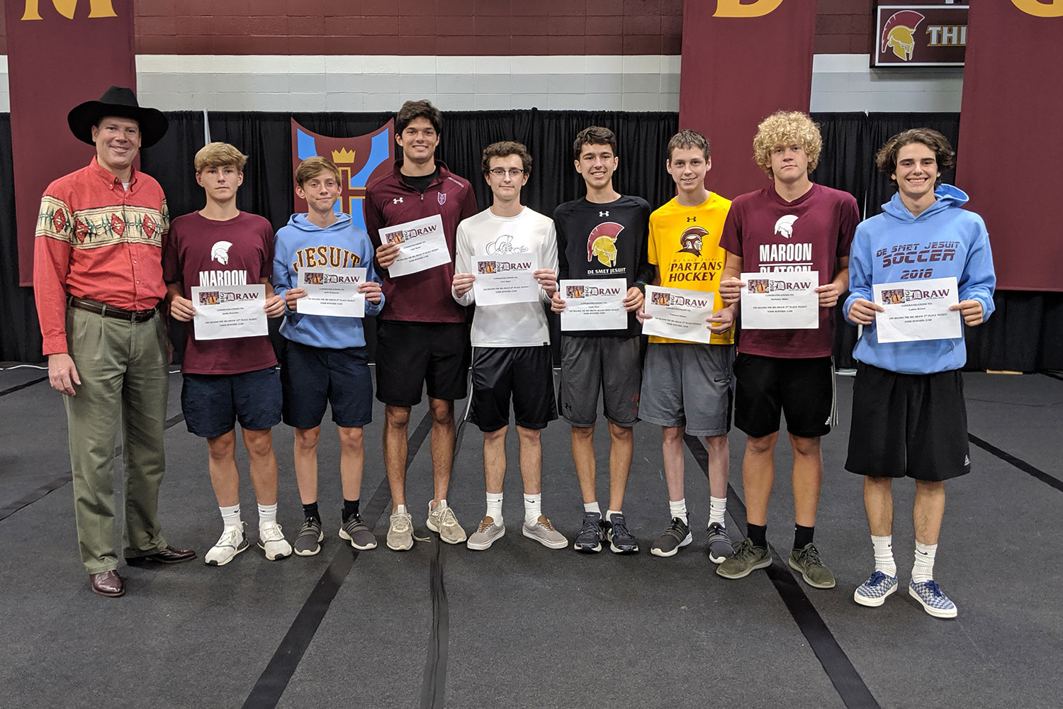 Big Draw Spokesman Gene Bender celebrates with several of the students who sold the winning tickets. They include Justin Roschke '22, Jack Bednarek '22, Luke Bauer '20, Evan Jager '20, Louis Hess '21, Cameron Gibson '21, Nick Miller '20, and Caden Brown '20.