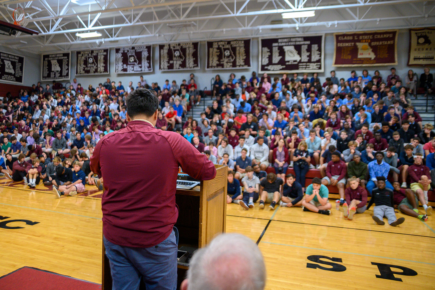 Gael Cosgaya '21 speaks to the student body during the Hispanic Heritage Month assembly about the trials and tribulations of his family as they moved to the United States from Mexico.