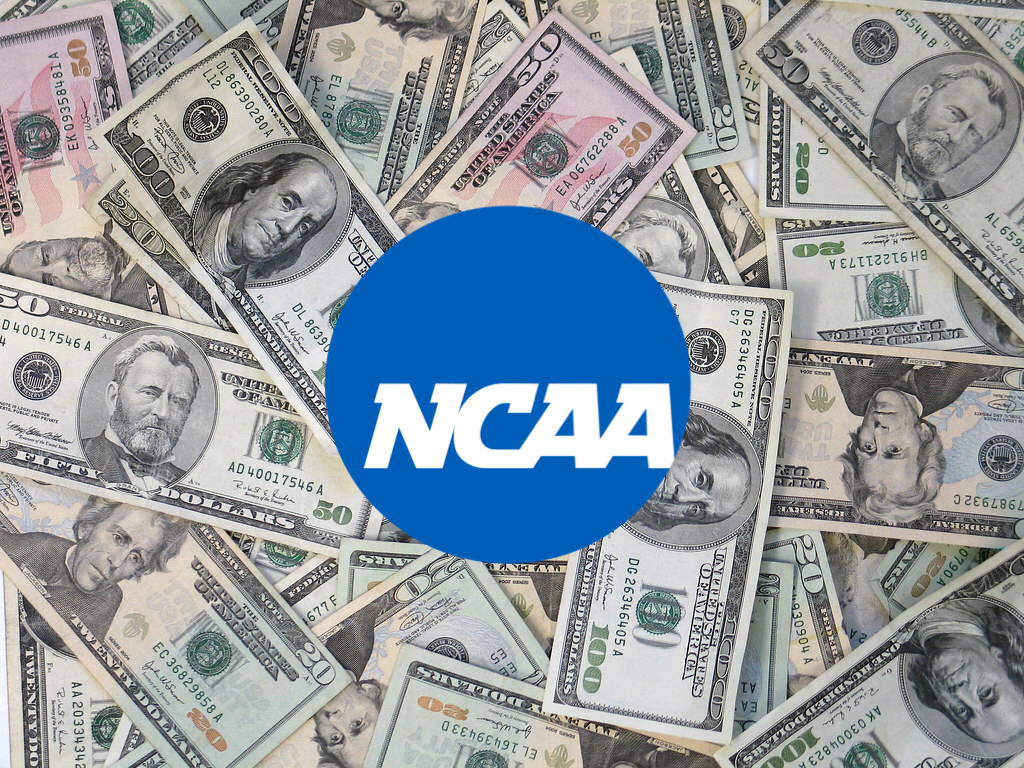 Paying college athletes could cause colleges to lose too much money.