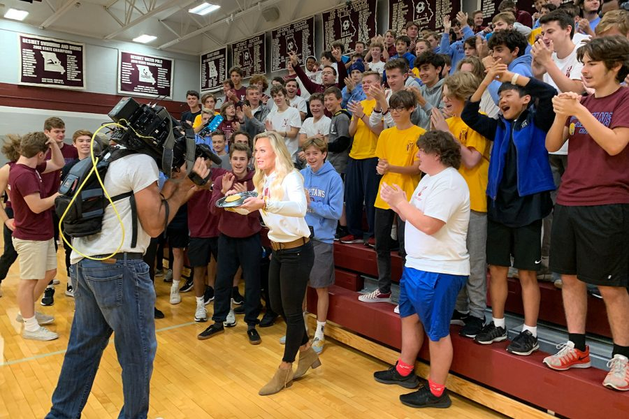 A+crowd+of+students+gathers+around+Fox+2+reporter+Katherine+Hessel+during+a+live+shot+Friday+morning+as+part+of+the+Pep+Zone.+The+program+featured+De+Smet+in+their+Friday+football+coverage.
