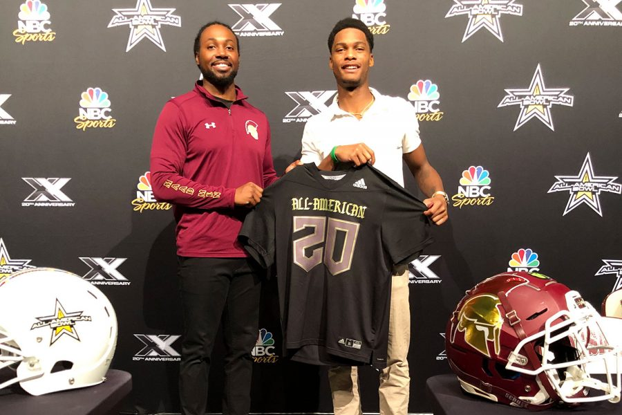 Senior wide receiver Jordan Johnson receives his All-American Bowl jersey with head coach Robert Steeples. The Notre Dame recruit is one of two Missouri players to get invited to the Jan. 4 all-star game.