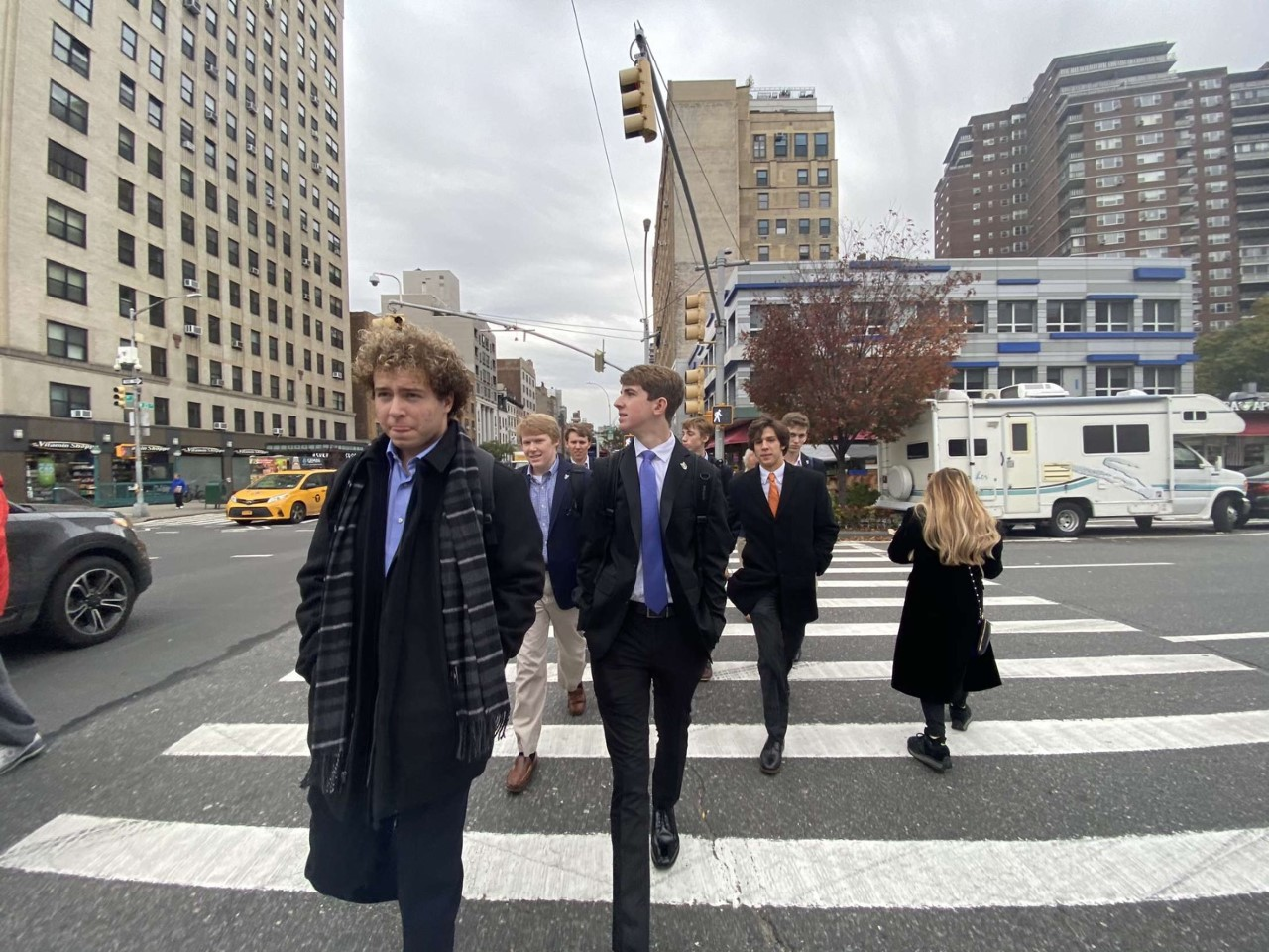 Seniors Seth Roggenkamp and Nick Quarnstrom cross the street before a meeting with ABInbev