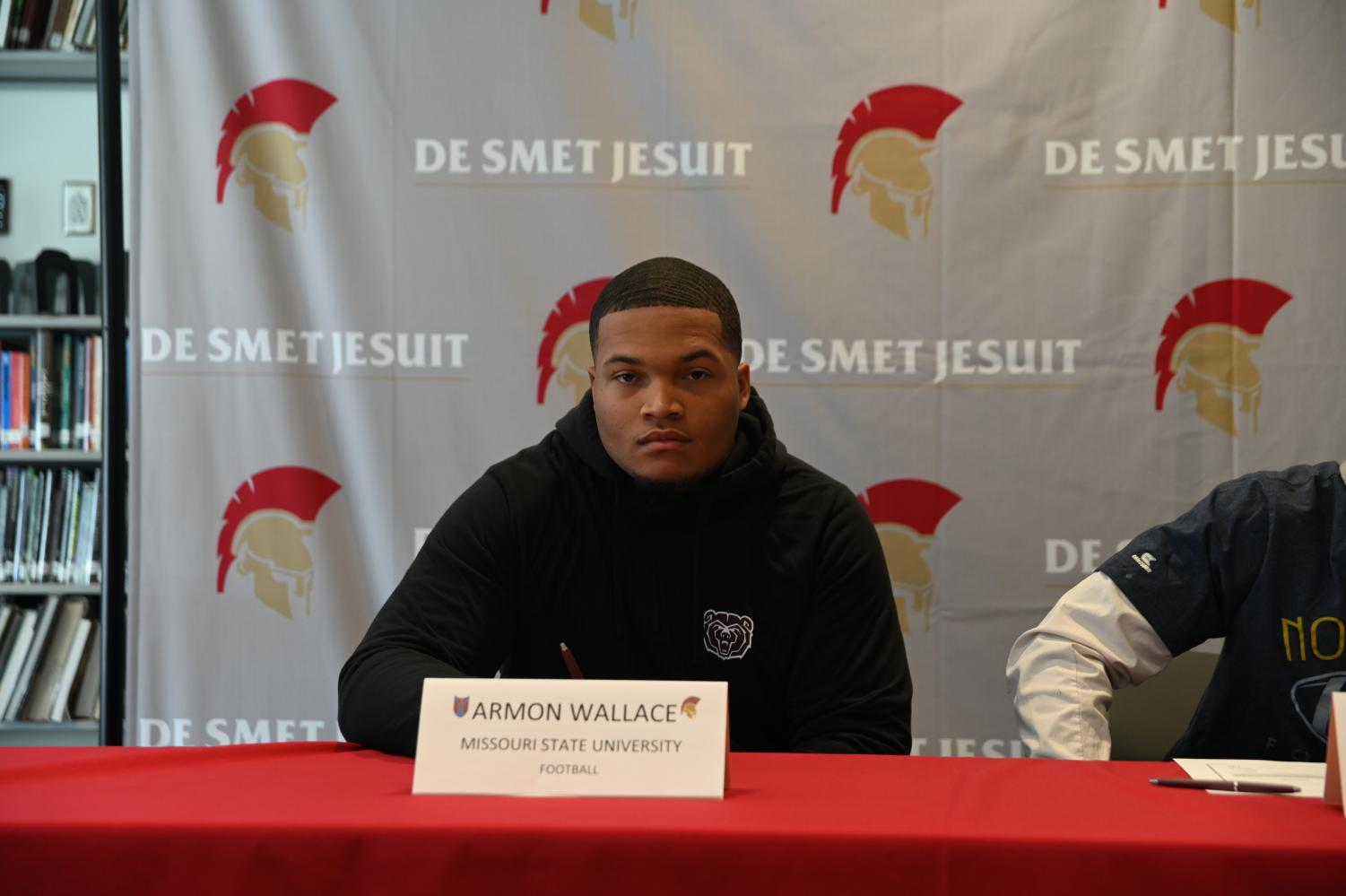 Senior Armon Wallace poses for a photo prior to signing to Missouri State University.