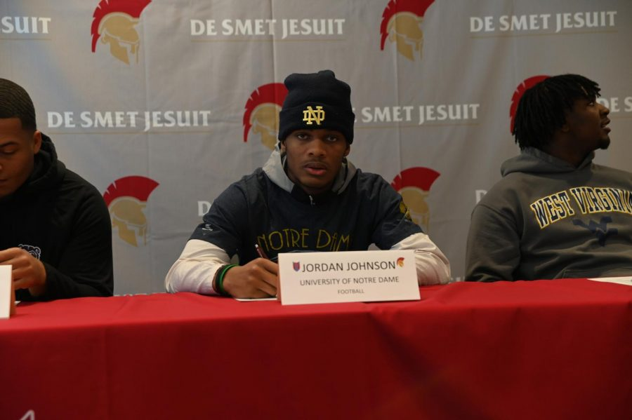 Senior+Jordan+Johnson+poses+for+a+photo+prior+to+signing+to+the+University+of+Notre+Dame.