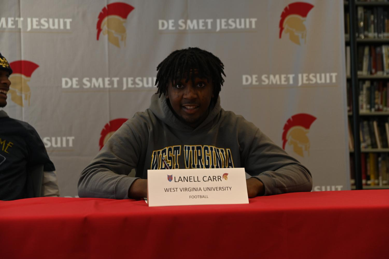 Senior Lanell Carr poses for a photo prior to signing to West Virginia University.
