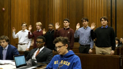 De Smet Mock Trial student witnesses are being swore in during practice trial.