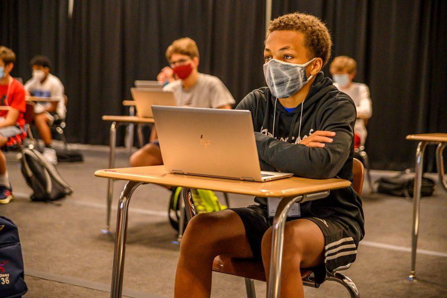 Freshmen Rico Bond prepares for the teacher to discuss plans for Odyssey in the Gym.