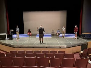 Senior Justin Kennedy rehearses a scene for the upcoming fall play