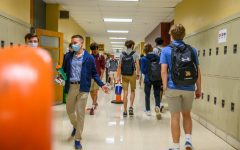 Students walk on the correct side of the hallways to stay spread out and help lower the chances of 	Spreading the Corona Virus.