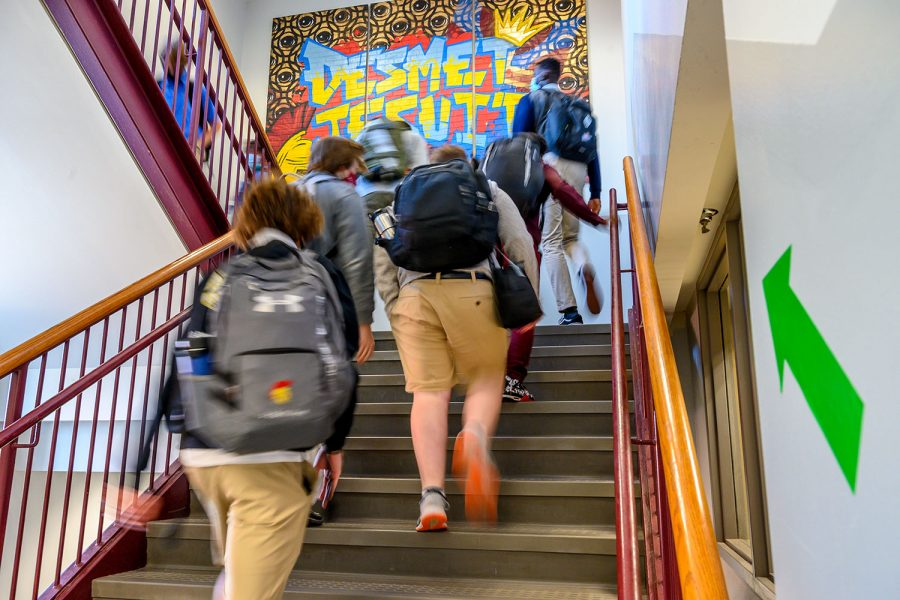 Students walk up the correct stairwell as there are specific stairwells to use as for going up and down stairs located around De Smet.