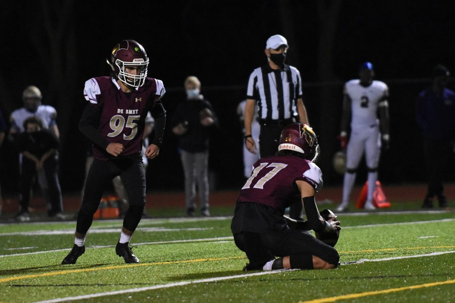 Junior kicker Luke Rothermich kicks an extra-point against CBC in the district semifinal football game Nov. 6.