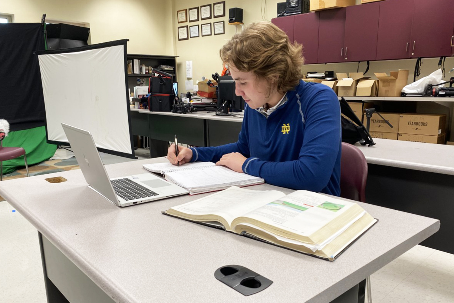 Senior Michael Cutler works on Calculus homework after school on March 11th, 2021.