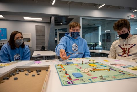 Vito Lafata and Ryan Zeiglar playing monopoly competing against the other peers teams on Formation Friday in the innovation center