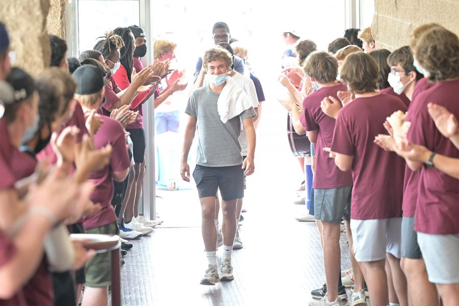 Owen Duff '25 walks into De Smet Jesuit High School surrounded by upperclassmen during Freshman Odyssey on August 6th, 2021. Freshman Odyssey is the first formative experience in a student's time at De Smet. It encourages team-building and bonding with your classmates and takes place before the beginning of the school year.